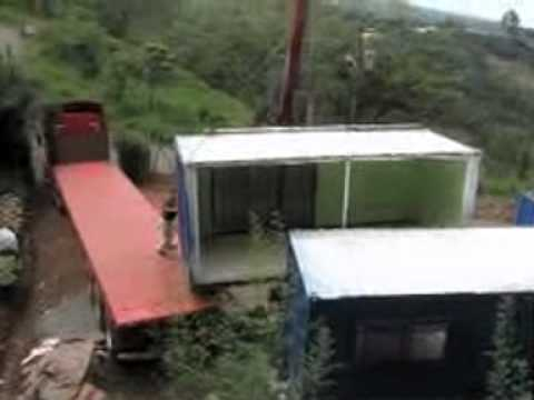 Loading with a crane, 2 20ft shipping container homes.mov